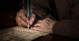 Hände schreiben einen Brief im Mittelalter - Thomas Mucha (AdobeStock: 194743250)